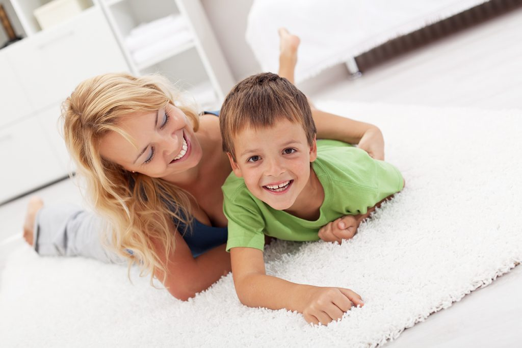 mum with boy on carpet